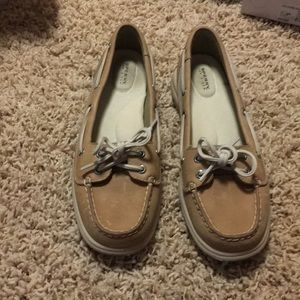 Tan Sperry boat shoes